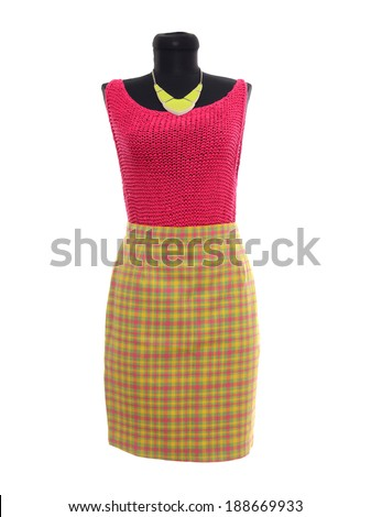 Pink blouse and neon yellow plaid skirt on mannequin. Woman autumn outfit on tailor's dummy isolated on white background. - stock photo