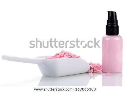 pink body lotion in dispenser and aroma salt isolated wellness spa cosmetic - stock photo