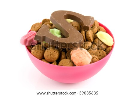 Pink bowl with pepernoten and candy isolated on white background - stock photo