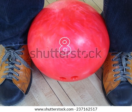 pink bowling ball, Colorful bowling balls in front of the tenpin alley with shoes background, sport competition.  - stock photo