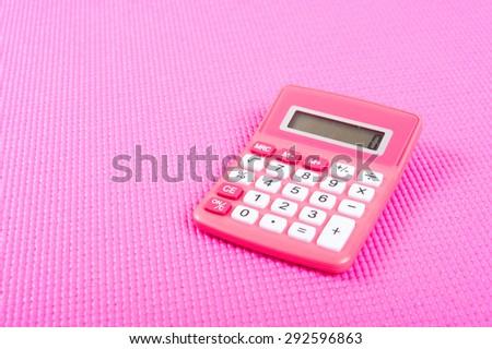 Pink calculator - stock photo