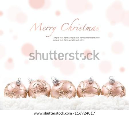 pink christmas balls on snow - stock photo