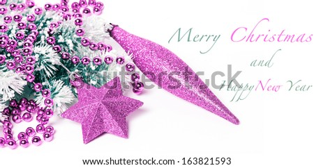 Pink Christmas decorations on snowy pine branch with sample text - stock photo