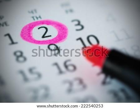 Pink circle. Mark on the calendar at 2. - stock photo