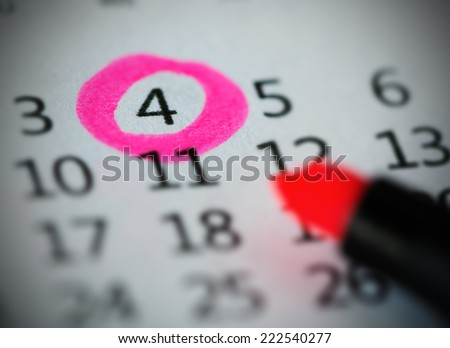 Pink circle. Mark on the calendar at 4. - stock photo