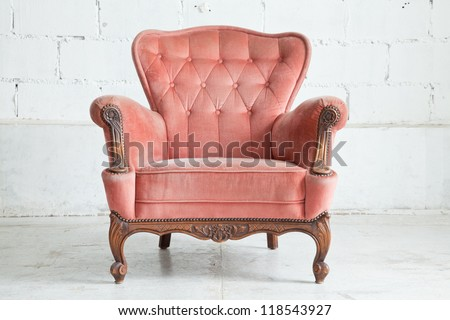 Pink classical style Armchair sofa couch in vintage room - stock photo