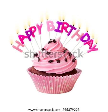 Pink cupcake decorated with birthday candles - stock photo