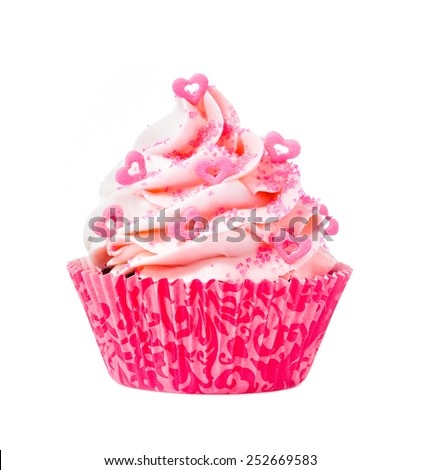 Pink Cupcake with heart sprinkles isolated on a white background. - stock photo