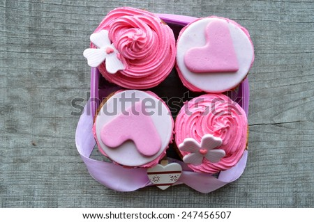 pink cupcakes, with cream ,decorated with hearts,Valentine's day,international women's day,love.Notepad.Valentine,love letter - stock photo