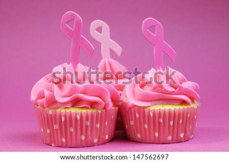 Pink cupcakes with Pink Ribbon symbol for International Breast Cancer Awareness charity month of October. Close up. - stock photo