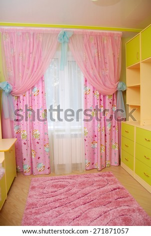 Pink curtains in a nursery. - stock photo