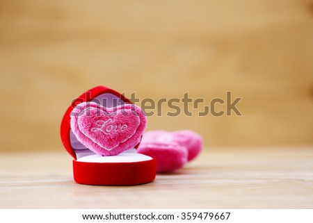 pink Cushion heart shape on wooden background - stock photo