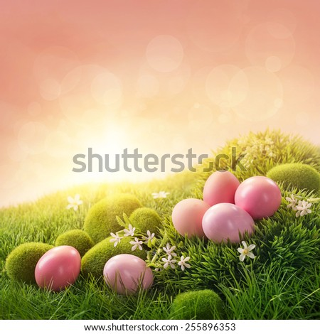 Pink easter eggs on grass - stock photo