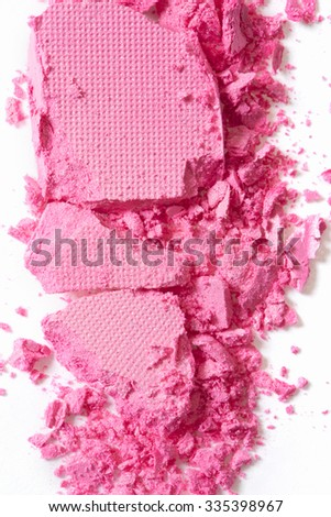 Pink eye shadow crushed cosmetic on white background - stock photo