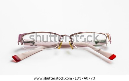 Pink eyeglasses isolated on white background - stock photo