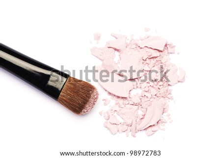 Pink eyeshadow and makeup brush - stock photo