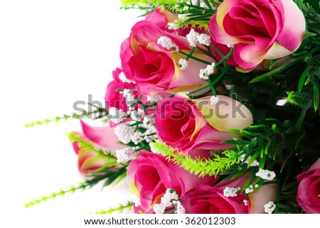 Pink fabric roses on white background. - stock photo