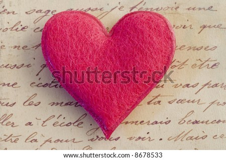 pink felt heart on handwritten letter - stock photo