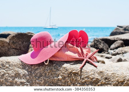 Pink Flip Flops Bag Starfish Accessories on Stone Beach Coastline Sea Relax Summer Vacation Holiday Concept Toned - stock photo