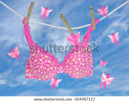pink floral bra with breast cancer awareness butterfly ribbons - stock photo