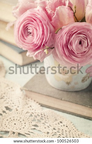 Pink flowers and old books - stock photo