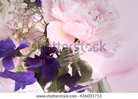 Pink Flowers in a vase, isolated against pink  - stock photo