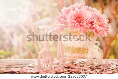 Pink flowers in the basket.Bicycle on Vintage Retro Soft Background.  - stock photo