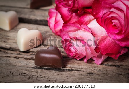 Pink fresh roses on wooden background - stock photo