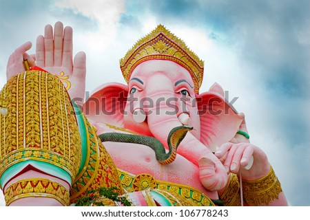 Pink ganecha in relaxing protrait on blue sky and white cloud,Ganesha Palace,Nakhonnayok,Thailand. - stock photo