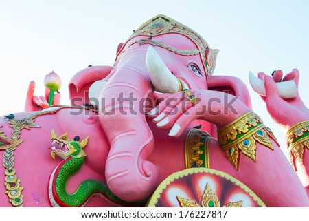 Pink Ganesha Statue on White Sky at Saman Rattanaram Temple, Chachoengsao Province, Thailand - stock photo