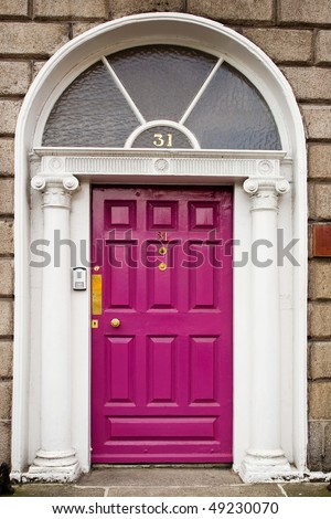 Pink georgian doors in Dublin - stock photo