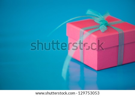 Pink Gift Box on a Blue Background - stock photo