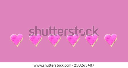 Pink  Gingerbread hearts Isolated on dark pink background - stock photo