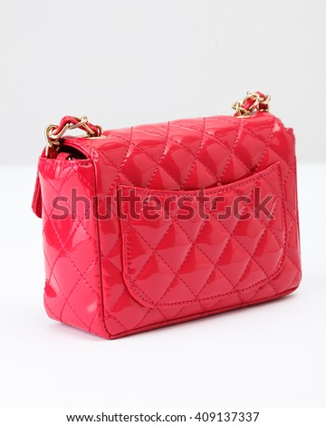 Pink glossy leather women bag on the white background - stock photo