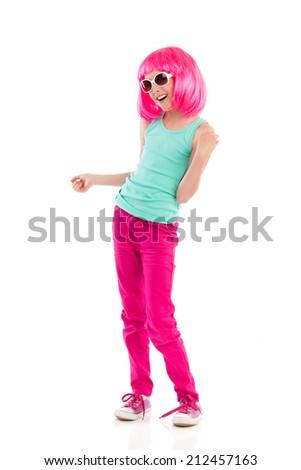 Pink haired girl in sunglasses posing. Full length studio shot isolated on white. - stock photo