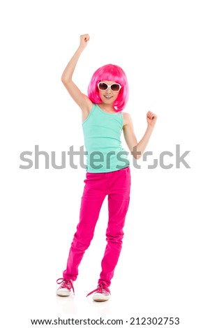 Pink haired girl in sunglasses raising arms and cheering. Full length studio shot isolated on white. - stock photo