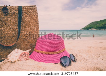 Pink hat, sunglasses and weave bag on Phuket island beach Thailand - Vintage effect style & selective focus - stock photo
