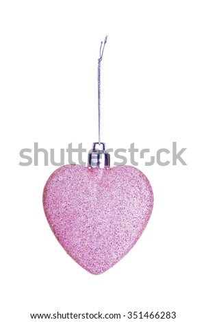 Pink heart tree ornament. A Christmas sparkling bauble on string isolated. - stock photo