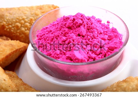 pink holi color in bowl with gujia - stock photo