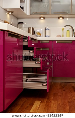 Pink kitchen in city flat - stock photo