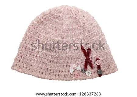 Pink knitted  hat for little girl with flowers and buttons decorations - stock photo