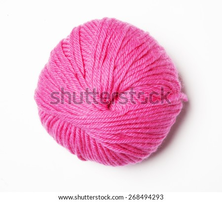 Pink knitting wool in front a white background - stock photo