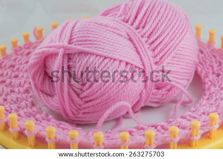 Pink knitting yarn and knitting tool on process - stock photo