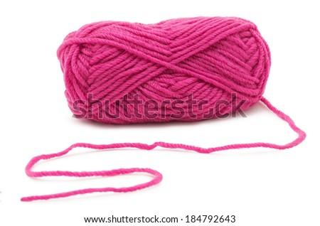 Pink knitting yarn isolated on white - stock photo