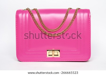 Pink lady's bag with a gold chain on a white background - stock photo