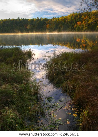 Pink lake on an autumn morning - stock photo