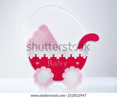 Pink little pram isolated on white - stock photo