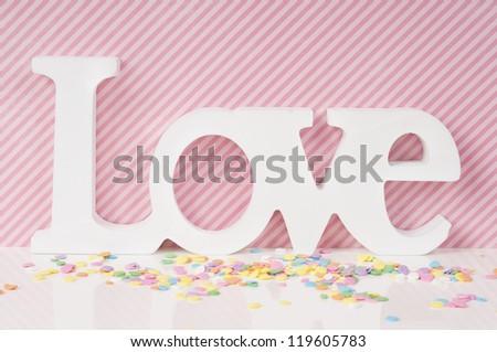 Pink Love Valentine card design with cupcake sprinkles - stock photo