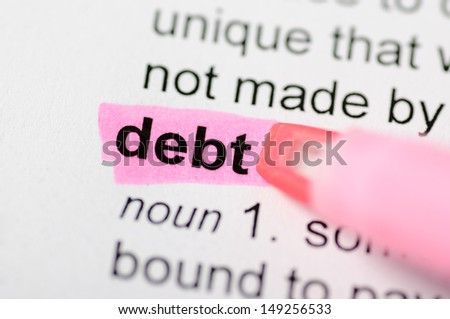 Pink marker on debt word  - stock photo