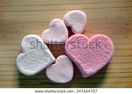 pink marshmallow for Valentine Day on rustic table - stock photo